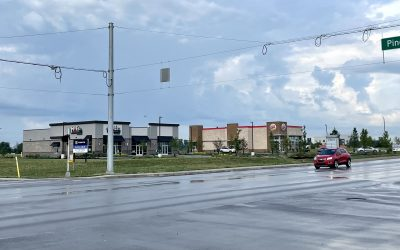 Pair of Stoplights Being Added to Busy Intersections